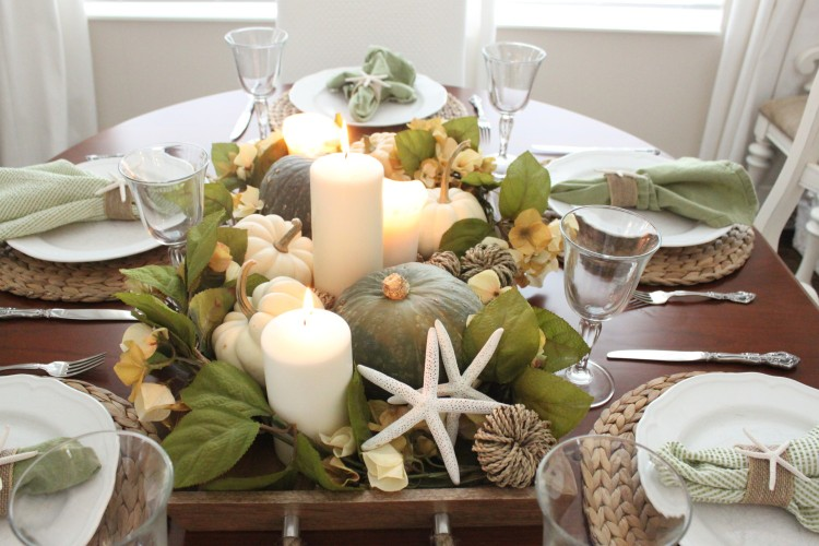 coastal-fall-decor-dining-table-centerpiece-autumn-accessories-seasonal-produce-natural-table-setting-starfish-pumpkins-leaves-candles.jpg
