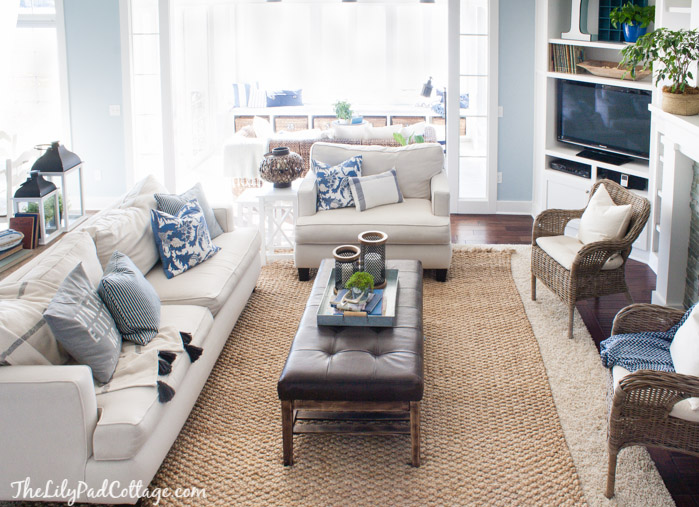 coastal-home-layered-rugs-textured-rug-blue-and-white-living-room-area-rug-wicker-furniture-mixed-seating