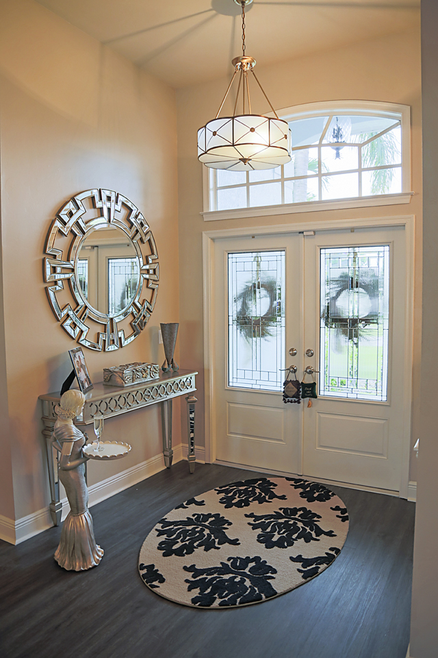 lori-manning-design-1425-sw-50th-st_0011-mariana-home-entry-lighting-greek-key-round-decorative-mirror-mirrored-console-entry-rug