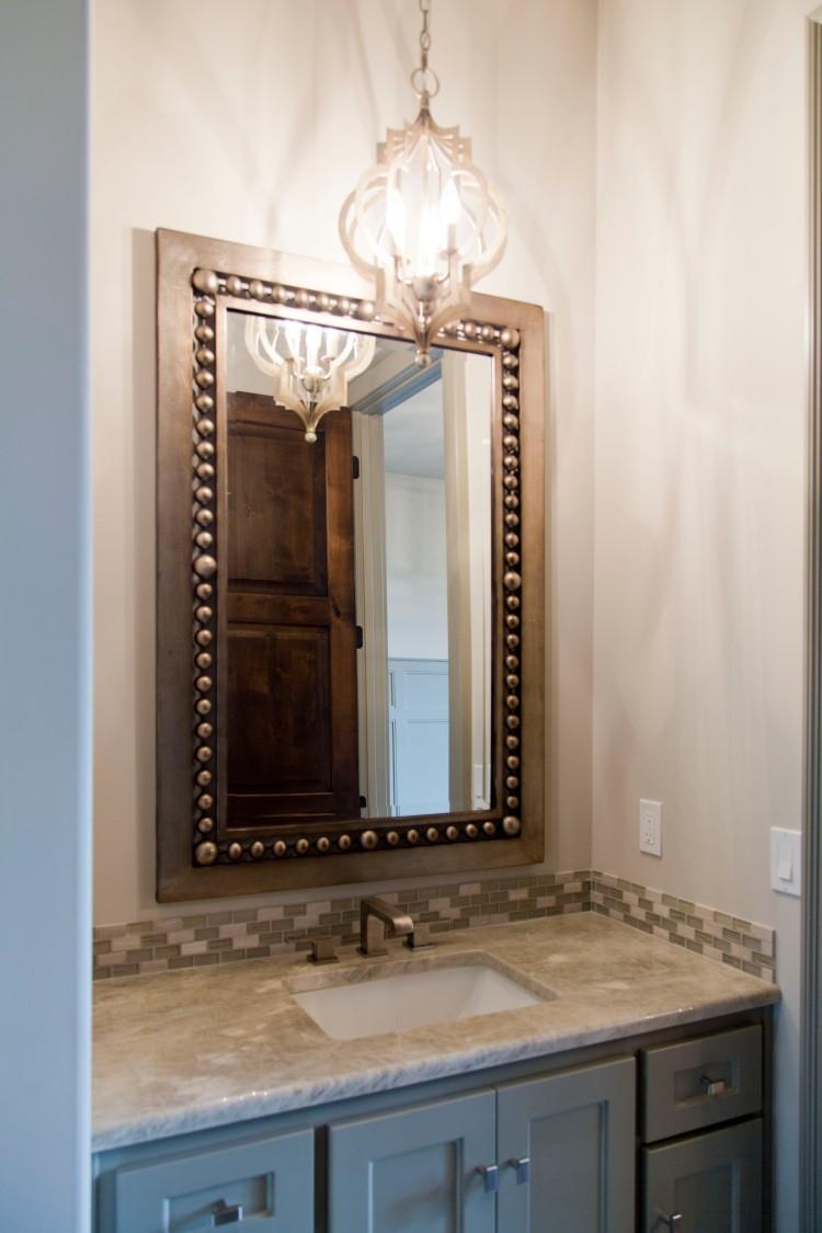 CecilRayHomes_081-Mariana Home-small-pendant-bathroom-lighting-vanity-lights-bathroom-mirror.jpg