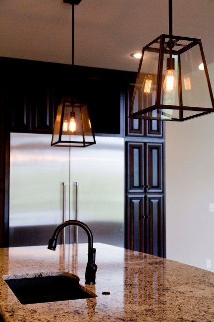 LarsonHome_074-Mariana Home-kitchen-island-lantern-pendants-bronze-finish.jpg
